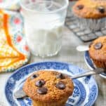 Front shot of banana chocolate chip muffin on a small blue and white plate