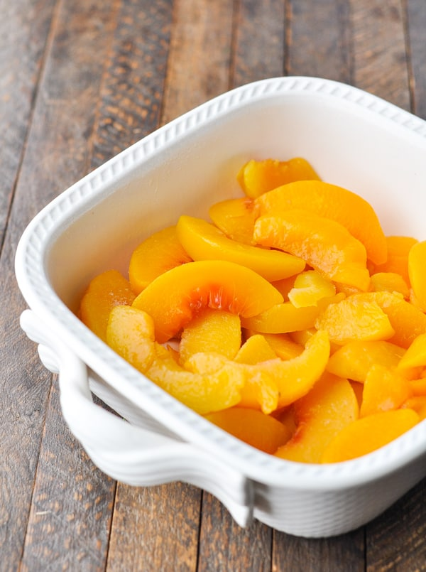 Peaches in a white baking dish