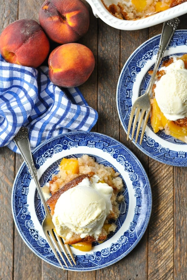 Overhead shot of bisquick peach cobbler topped with a scoop of vanilla ice cream