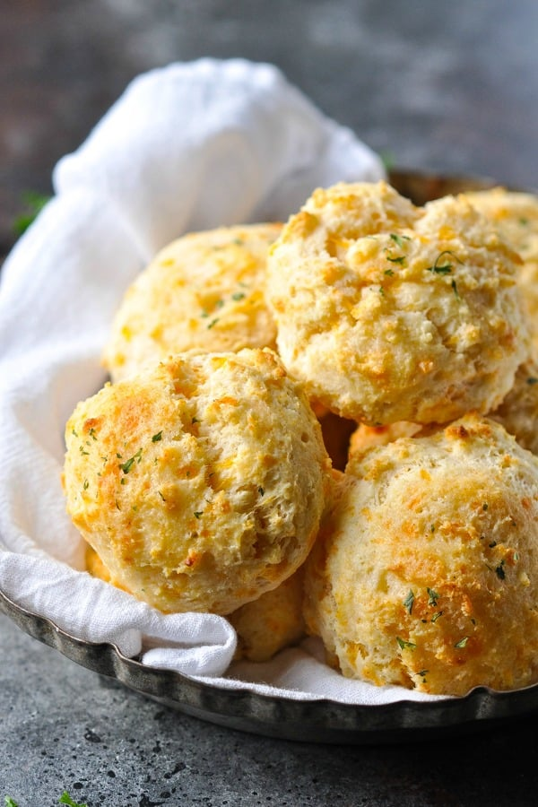 Close up side shot of a bowl of homemade Cheddar Bay Biscuits just like at Red Lobster
