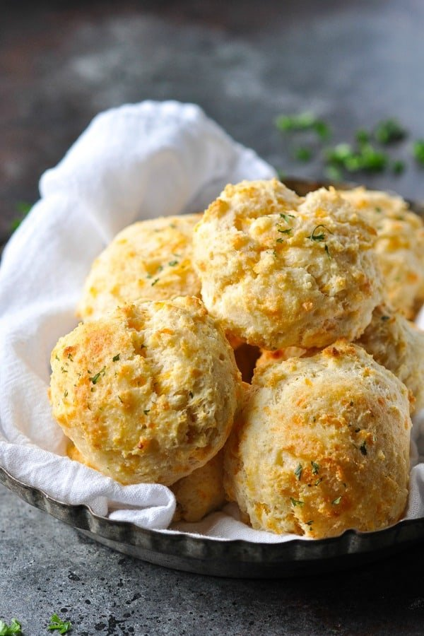 Bowl of garlic cheese biscuits on a white cloth