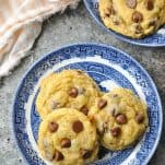 Overhead shot of three chocolate chip pudding cookies on a blue and white plate
