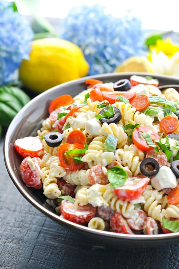 Front shot of a big bowl of an easy Creamy Pasta Salad recipe with Italian dressing