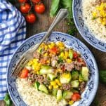 Overhead shot of a bowl of ground beef with summer vegetables and rice