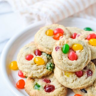 Close up front shot of white plate piled high with jelly bean cookies
