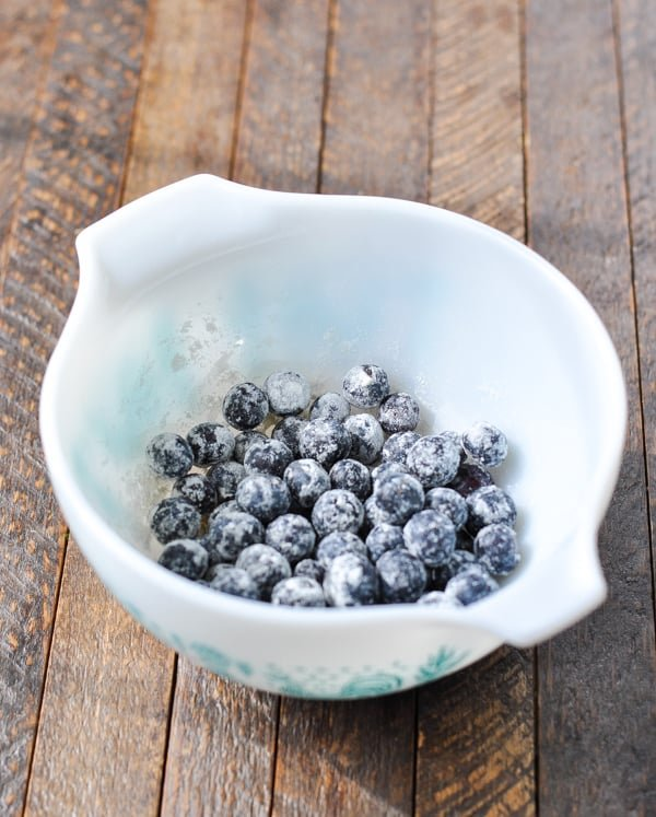 Bowl of blueberries tossed with flour