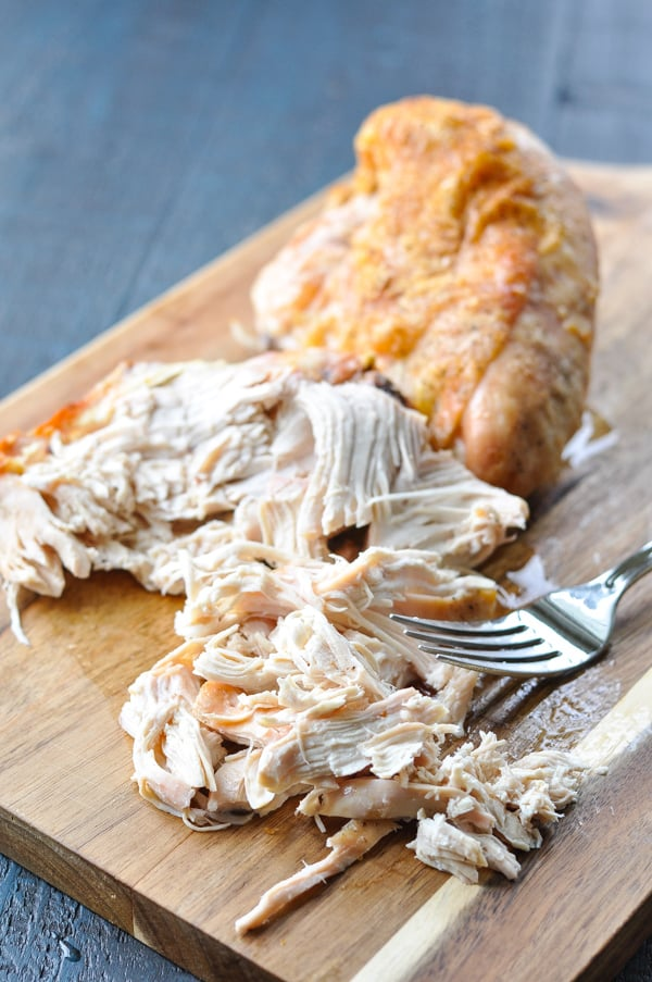 Shredding roasted chicken breast for soup