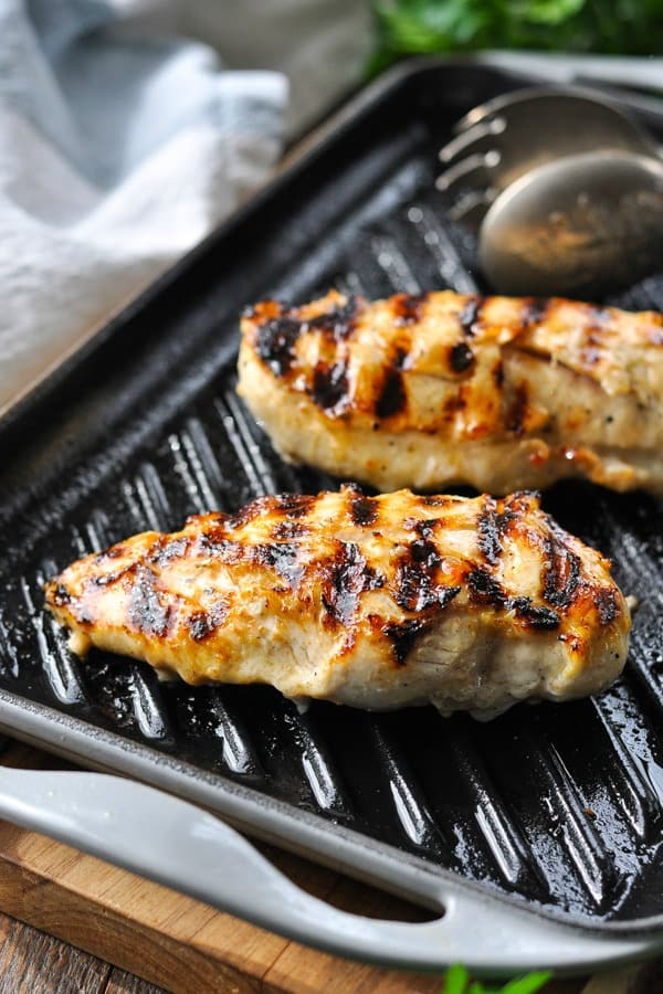 Italian marinated chicken breasts on a grill