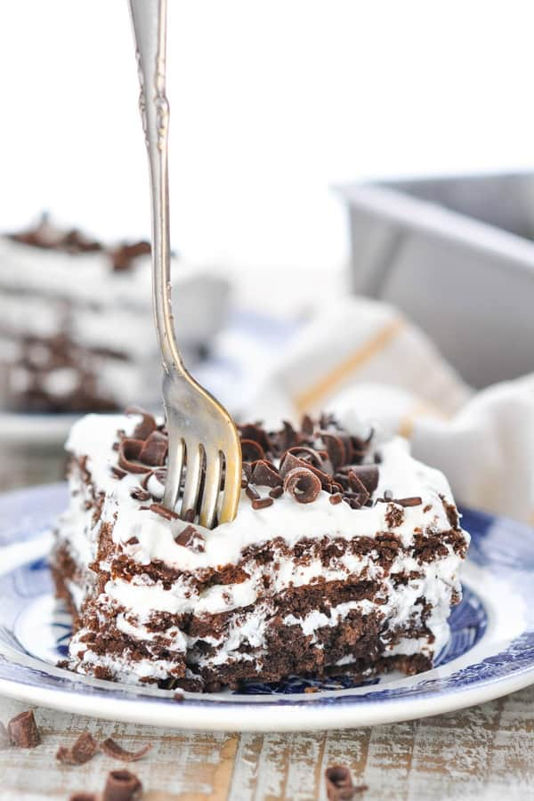 Fork digging into a slice of icebox cake