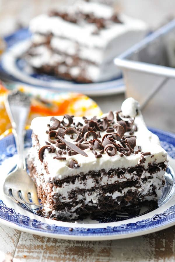 Front shot of a slice of icebox cake on a blue and white plate