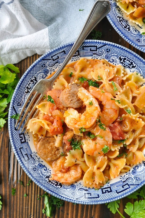 Close overhead shot of a bowl of shrimp and sausage bowtie pasta