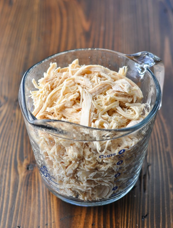Shredded chicken in a glass measuring cup