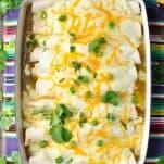 Overhead shot of Sour Cream Chicken Enchiladas in a white baking dish