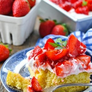 Close up front shot of a piece of Strawberry Shortcake Cake on a serving plate