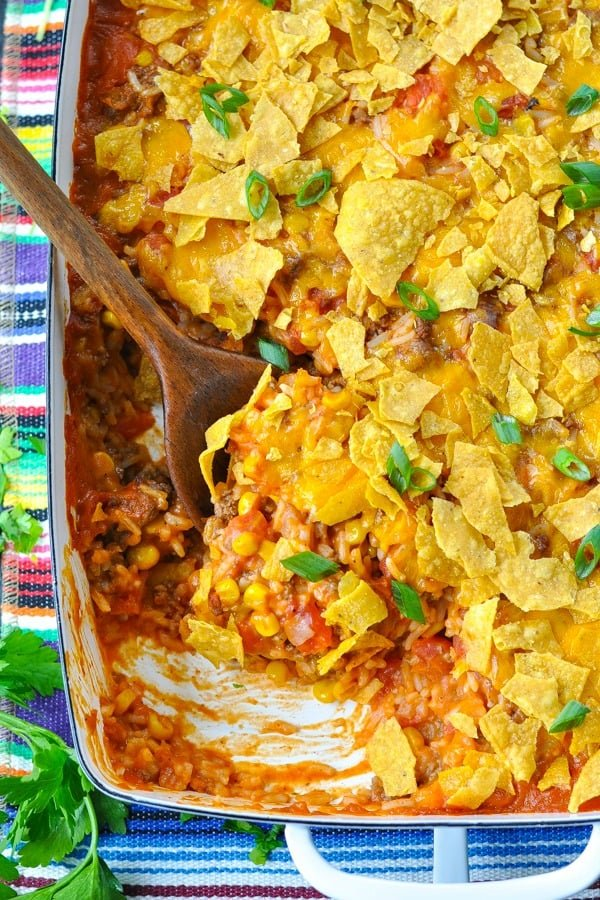 Close overhead shot of taco casserole with rice in a white baking dish