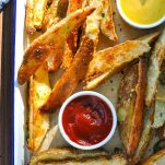Close overhead shot of a tray of baked potato wedges