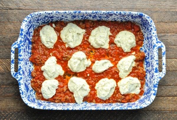 Ricotta layered in baked ziti casserole