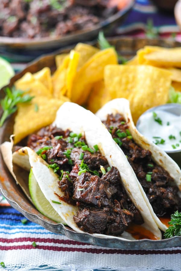 Close up front shot of crock pot beef barbacoa tacos on a plate