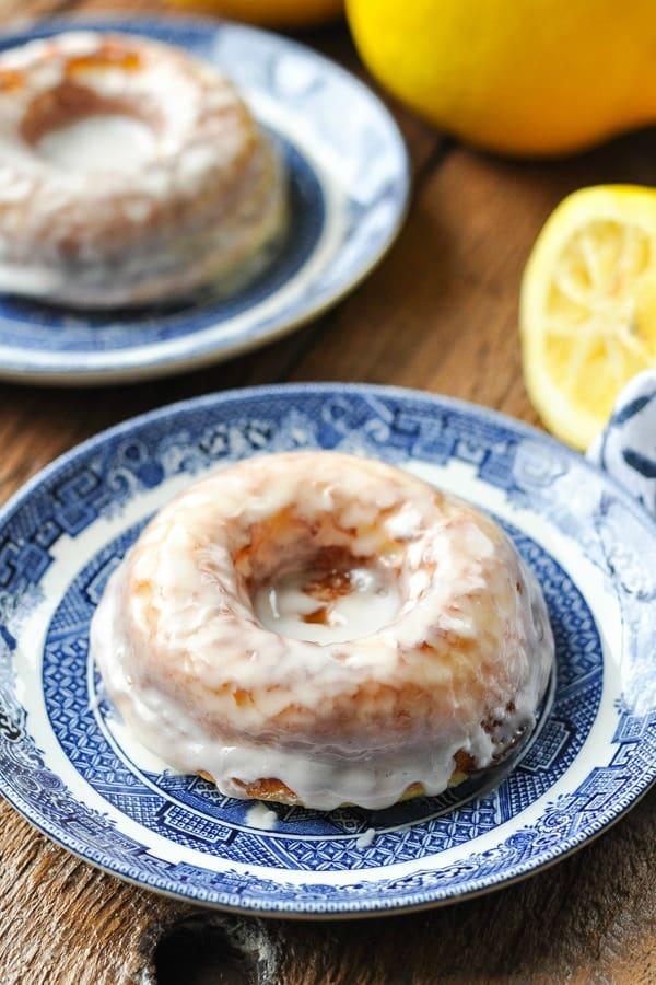 Baked donut on a plate with lemons in the background