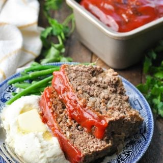 Front shot of a classic meatloaf and mashed potatoes dinner on a wooden table