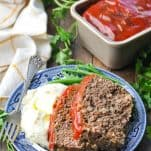 Front shot of meatloaf with mashed potatoes and green beans