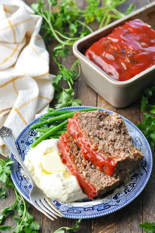 Plate of old fashioned meatloaf on a wooden table