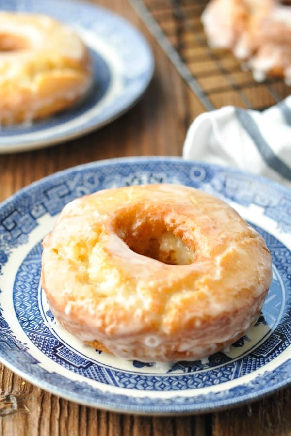 Front shot of homemade old fashioned donut on a blue and white plate