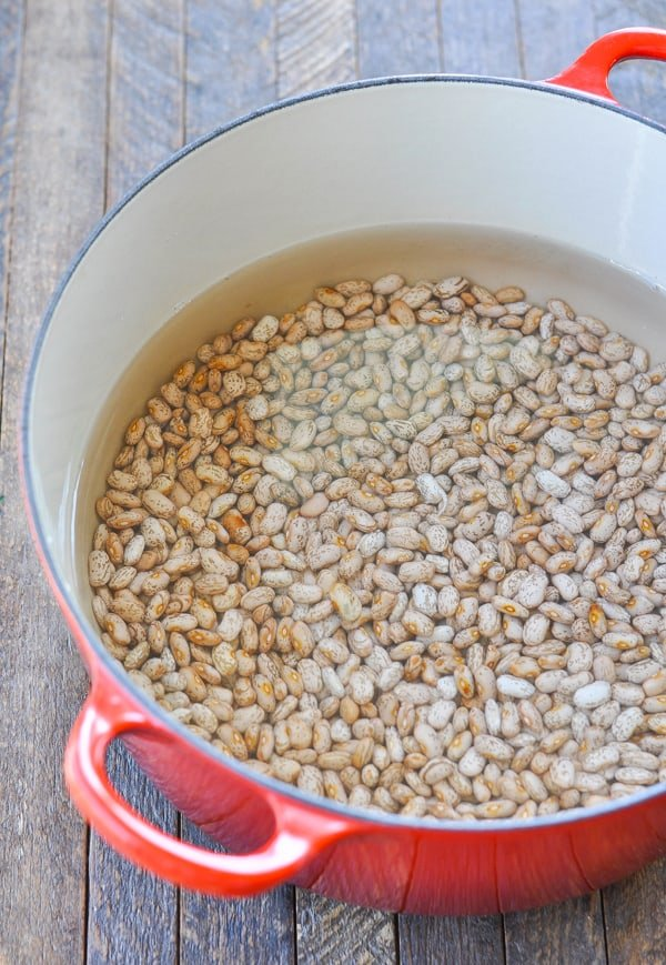 Soaking dried pinto beans in a dutch oven