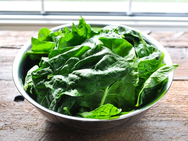Bowl of fresh spinach leaves