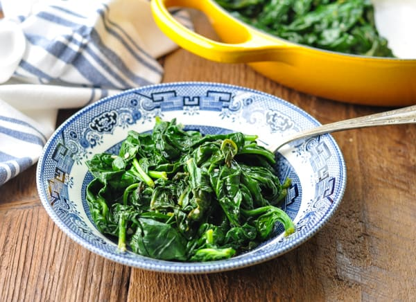 Horizontal shot of a bowl of sauteed spinach