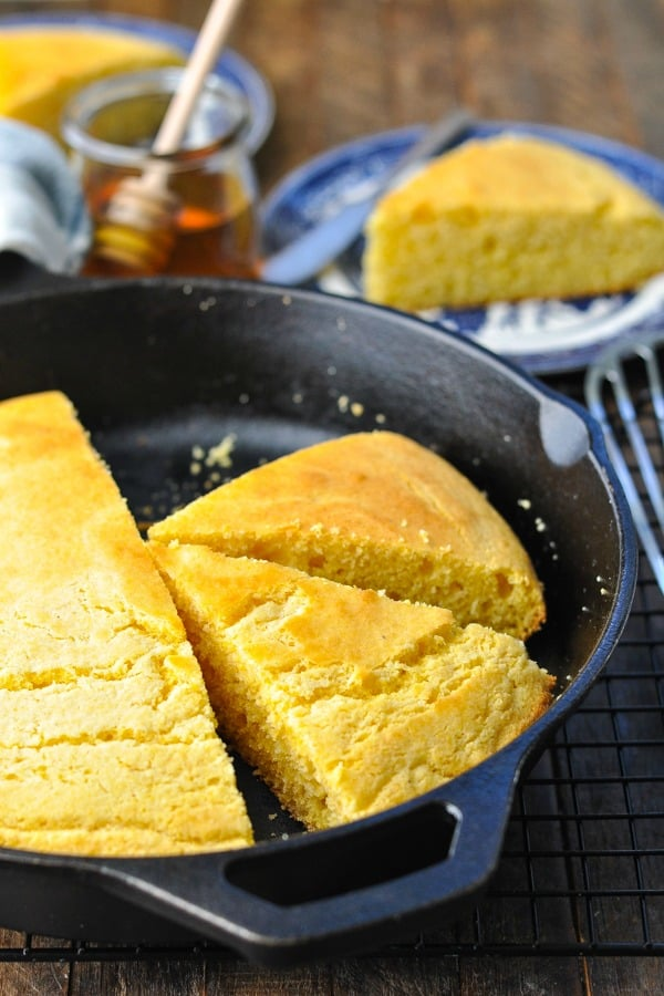 Close up front shot of cornbread in a cast iron skillet