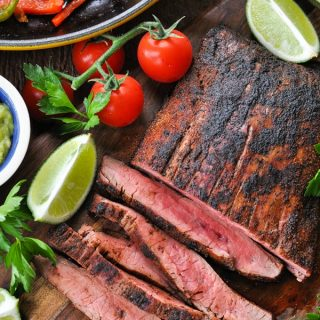 Close overhead shot of sliced steak fajitas recipe on a cutting board