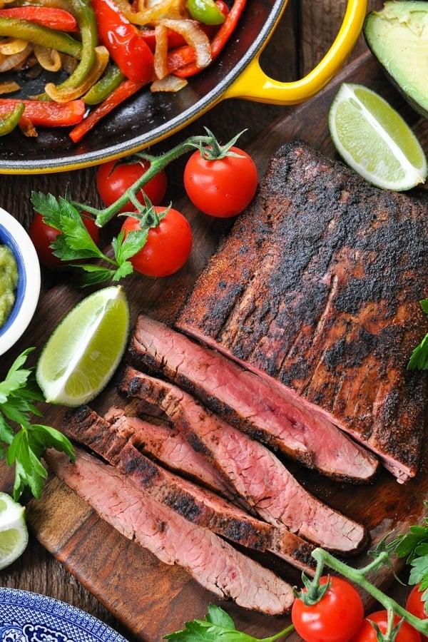 Close overhead shot of sliced steak fajitas recipe on a cutting board