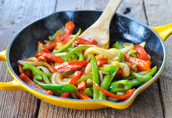 Peppers and onions for fajitas in a skillet