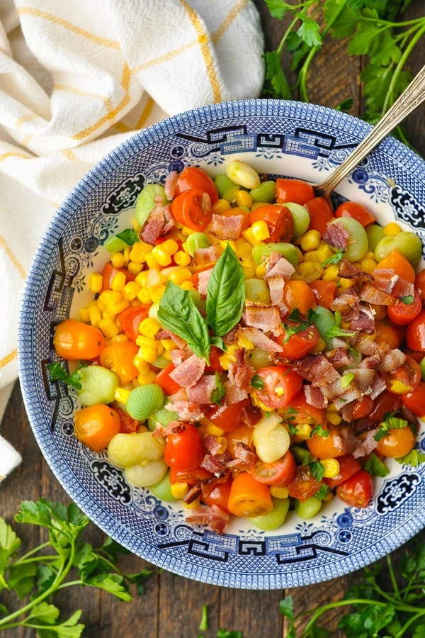 Close overhead shot of a bowl of Southern succotash surrounded by parsley