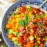 Silver spoon in a bowl of southern succotash recipe