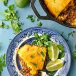 Overhead shot of tamale pie on a bright blue cafe table