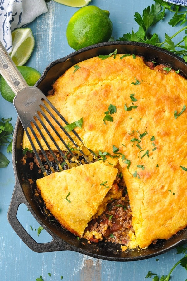 Close overhead shot of tamale pie in a cast iron skillet