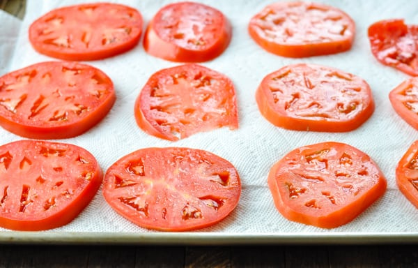 Tomato slices on paper towels