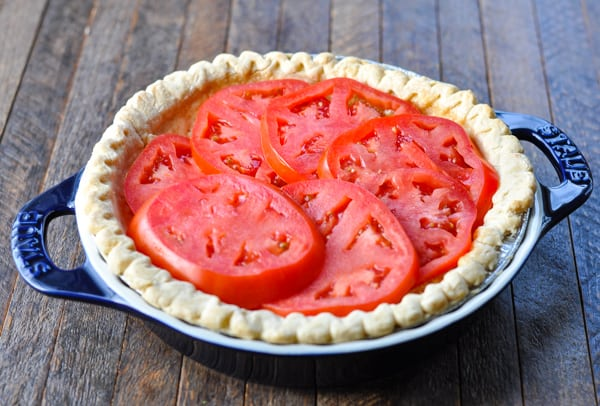 Layering tomatoes in a pie crust