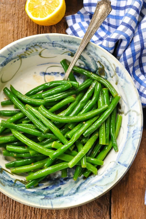 Shot from above of Amish Green Bean recipe in a bowl tossed with brown butter