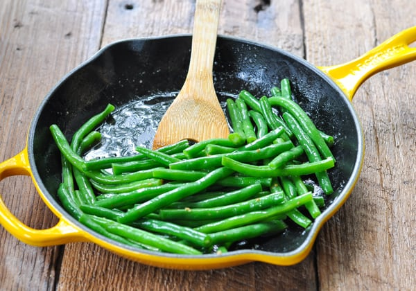 Sauteing green beans in a cast iron skillet