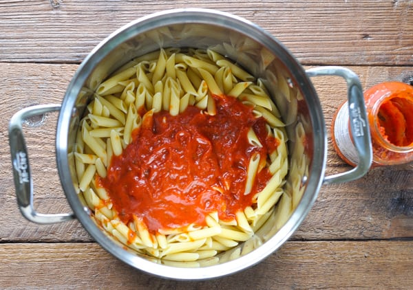 Penne pasta and marinara sauce in a pot