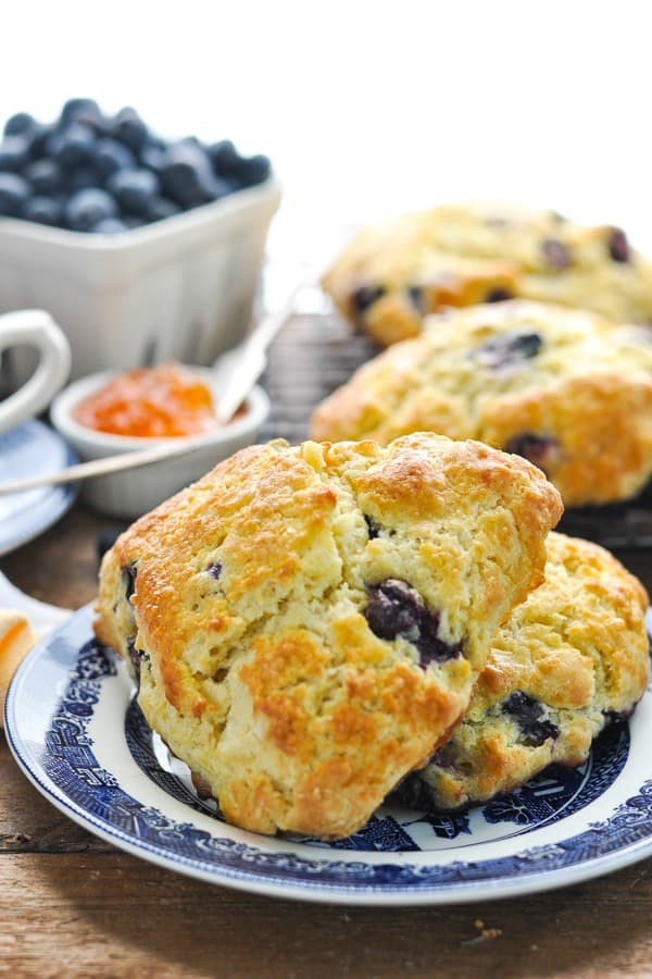 Close up front shot of two blueberry scones on a plate