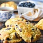 Blueberry scones piled on a cooling rack