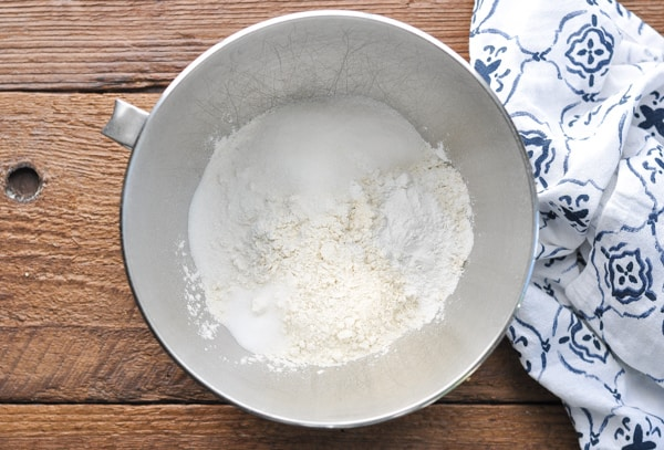 Overhead shot of dry ingredients for scones in a mixing bowl