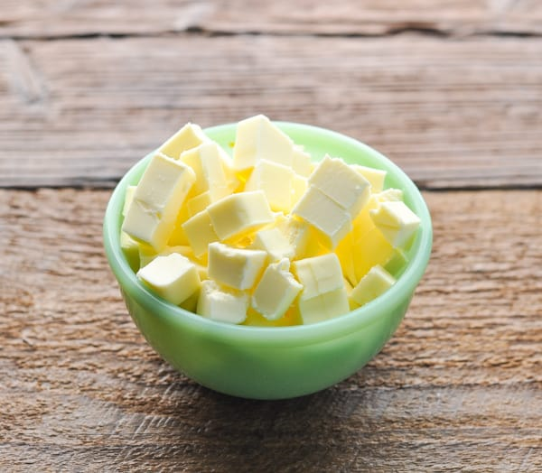 Diced butter in a small green bowl