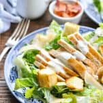 Close up front shot of a plate full of Chicken Caesar Salad