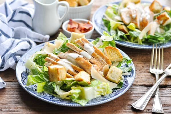Horizontal shot of a plate of chicken caesar salad