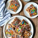 Overhead shot of chocolate covered graham crackers on a wooden table